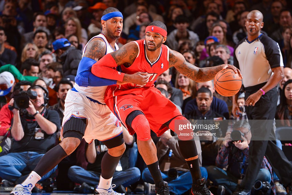 Josh Smith #5 of the Atlanta Hawks posts up against Carmelo Anthony #7 of the New York Knicks at Madison Square Garden on January 27, 2013 in New York, New York.