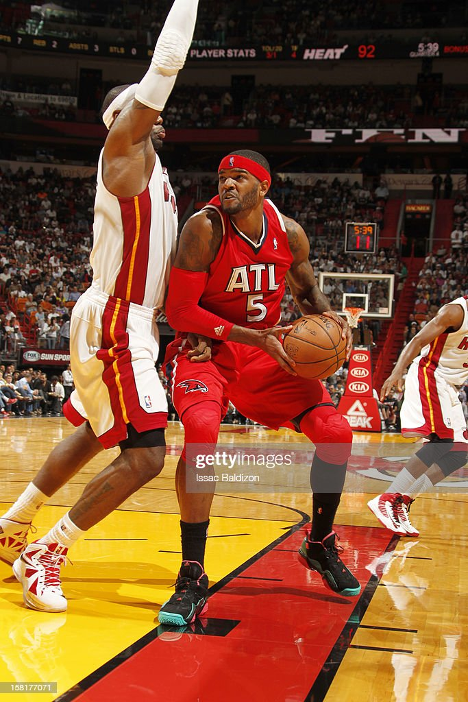 Josh Smith #5 of the Atlanta Hawks protects the ball during a game between the Atlanta Hawks and the Miami Heat on December 10, 2012 at American Airlines Arena in Miami, Florida.