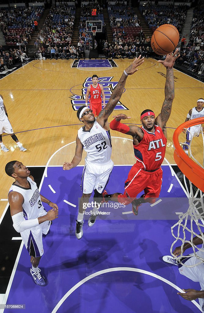 Josh Smith #5 of the Atlanta Hawks puts up a shot against James Johnson #52 of the Sacramento Kings on November 16, 2012 at Sleep Train Arena in Sacramento, California.