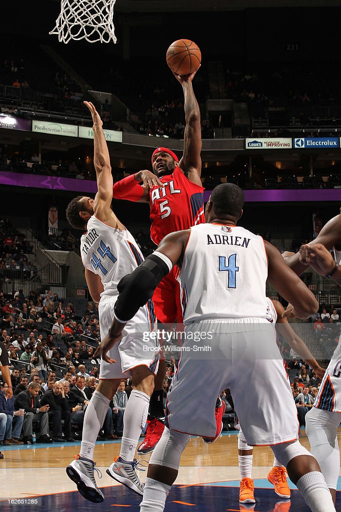 Josh Smith #5 of the Atlanta Hawks puts up a shot against the Charlotte Bobcats at the Time Warner Cable Arena on January 23, 2013 in Charlotte, North Carolina.