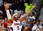 Josh Smith of the Atlanta Hawks reacts to the fans in the final minutes of their 10291 win over the Indiana Pacers during Game Four of the Eastern...
