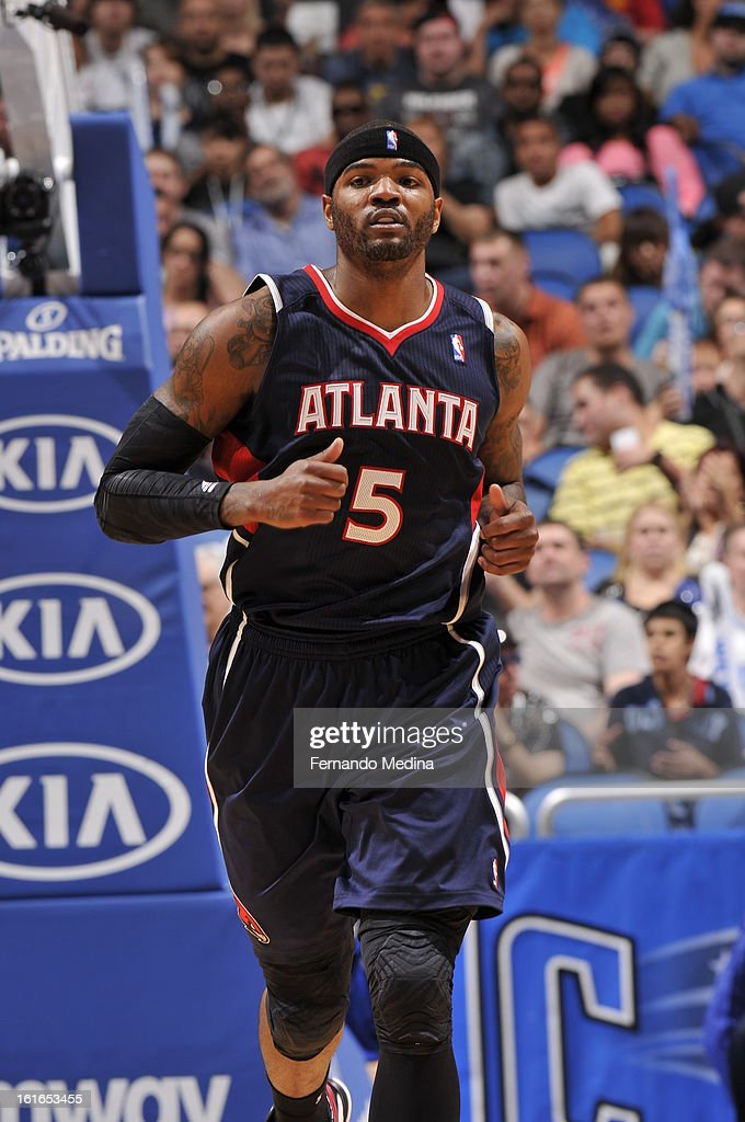Josh Smith #5 of the Atlanta Hawks runs back up the court against the Orlando Magic during the game on February 13, 2013 at Amway Center in Orlando, Florida.