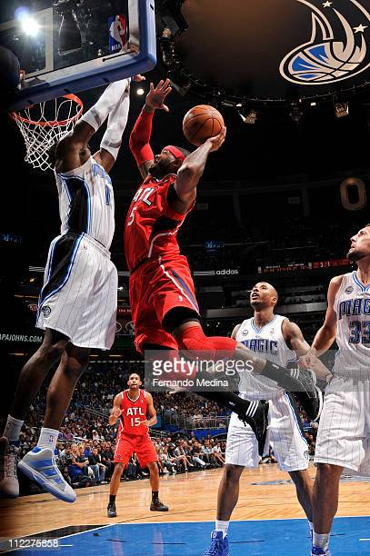 Josh Smith of the Atlanta Hawks shoots against Dwight Howard of the Orlando Magic during Game One of the Eastern Conference Quarterfinals in the 2011...