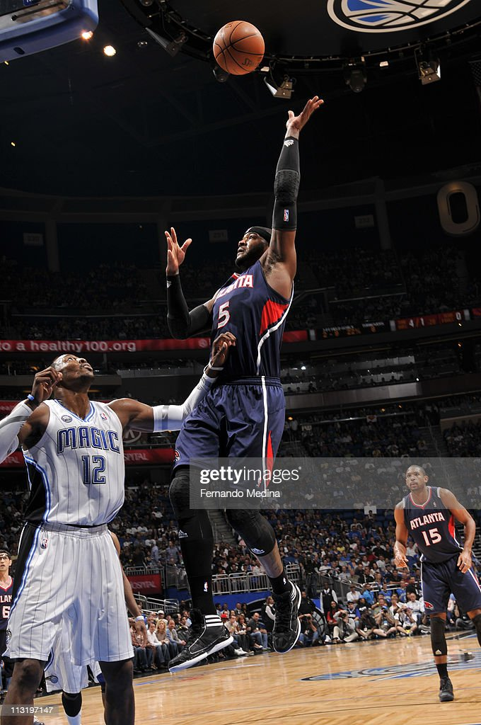 <a gi-track='captionPersonalityLinkClicked' href=/galleries/search?phrase=Josh+Smith+-+Basketball+Player+-+Born+1985&family=editorial&specificpeople=201983 ng-click='$event.stopPropagation()'>Josh Smith</a> #5 of the Atlanta Hawks shoots against <a gi-track='captionPersonalityLinkClicked' href=/galleries/search?phrase=Dwight+Howard&family=editorial&specificpeople=201570 ng-click='$event.stopPropagation()'>Dwight Howard</a> #12 of the Orlando Magic in Game Five of the Eastern Conference Quarterfinals in the 2011 NBA Playoffs on April 26, 2011 at the Amway Center in Orlando, Florida.