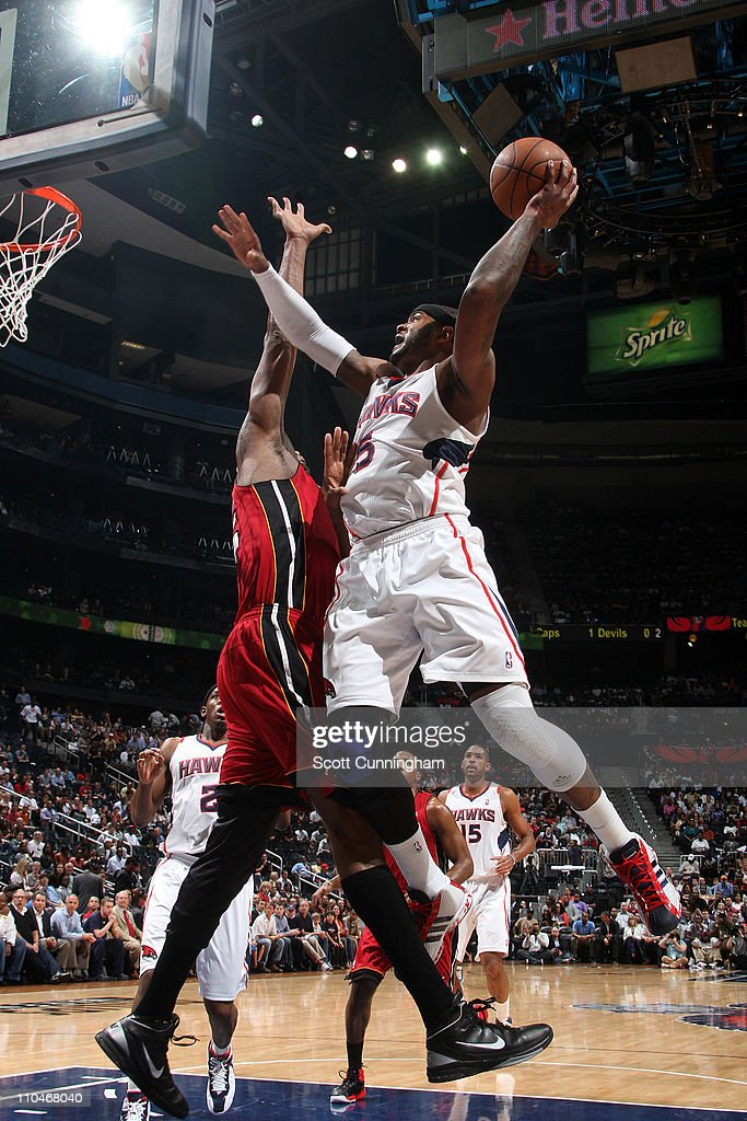 Josh Smith #5 of the Atlanta Hawks shoots against Erick Dampier #25 of the Miami Heat on March 18, 2011 at Philips Arena in Atlanta, Georgia.
