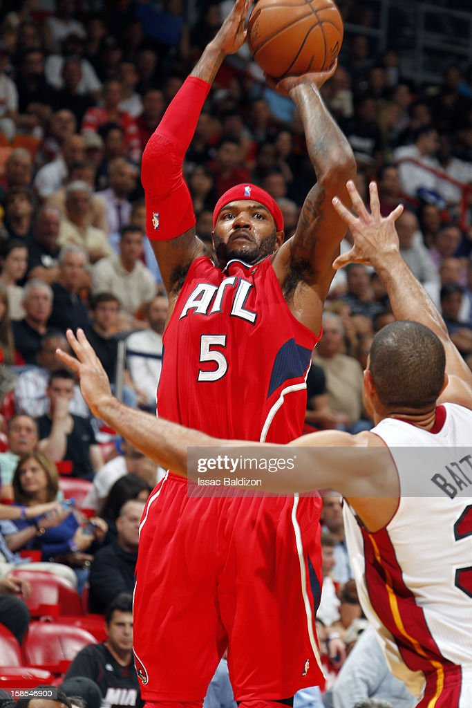 Josh Smith #5 of the Atlanta Hawks shoots against Shane Battier #31 of the Miami Heat on December 10, 2012 at American Airlines Arena in Miami, Florida.