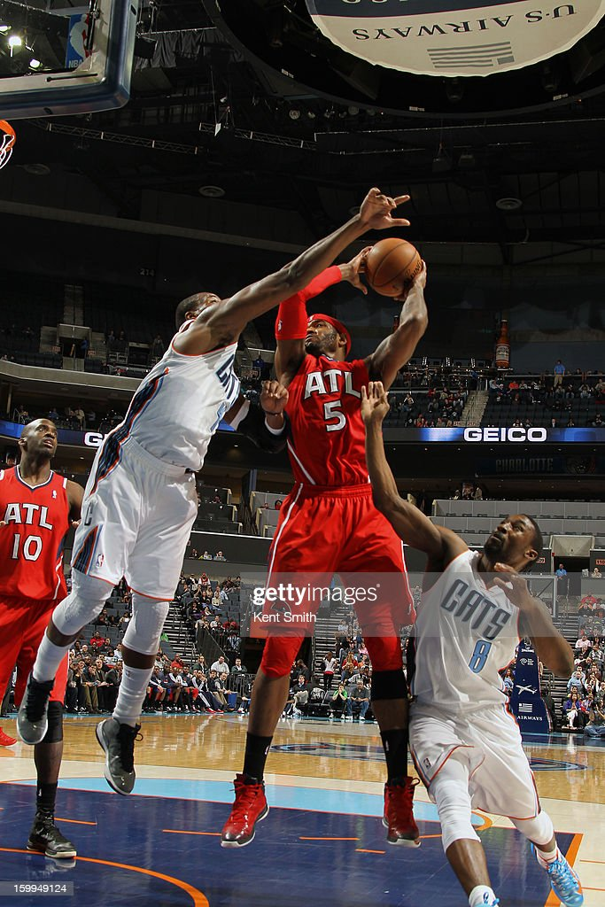 Josh Smith #5 of the Atlanta Hawks shoots against the Charlotte Bobcats at the Time Warner Cable Arena on January 23, 2013 in Charlotte, North Carolina.