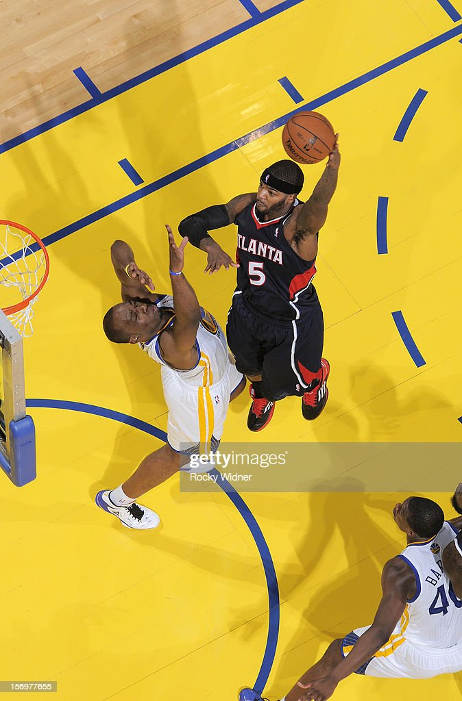 Josh Smith #5 of the Atlanta Hawks shoots the ball over Carl Landry #7 of the Golden State Warriors on November 14, 2012 at Oracle Arena in Oakland, California.