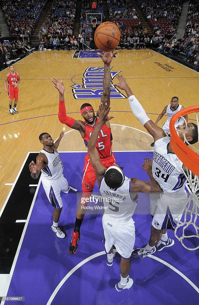 Josh Smith #5 of the Atlanta Hawks shoots the ball over John Salmons #5 of the Sacramento Kings on November 16, 2012 at Sleep Train Arena in Sacramento, California.