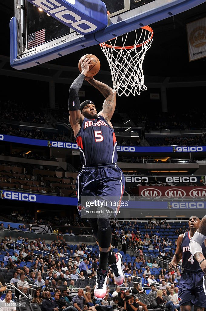 Josh Smith #5 of the Atlanta Hawks slam dunks the ball against the Orlando Magic during the game on February 13, 2013 at Amway Center in Orlando, Florida.