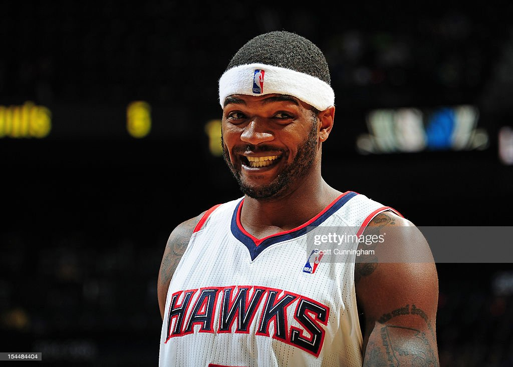 Josh Smith #5 of the Atlanta Hawks smiles during the game against the Dallas Mavericks at Philips Arena on October 20, 2012 in Atlanta, Georgia.