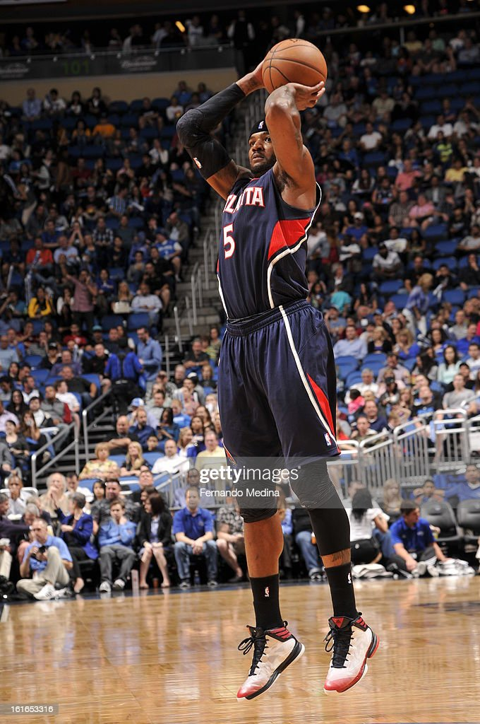 Josh Smith #5 of the Atlanta Hawks takes a jumpshot against the Orlando Magic during the game on February 13, 2013 at Amway Center in Orlando, Florida.