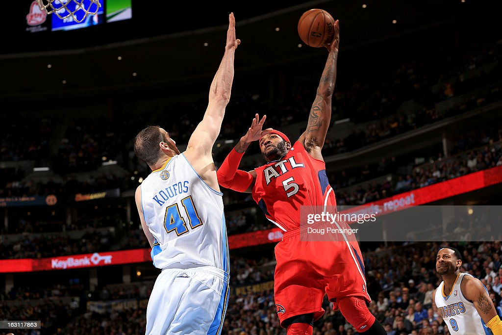 Josh Smith #5 of the Atlanta Hawks takes a shot over Kosta Koufos #41 of the Denver Nuggets at the Pepsi Center on March 4, 2013 in Denver, Colorado. The Nuggets defeated the Hawks 104-88.