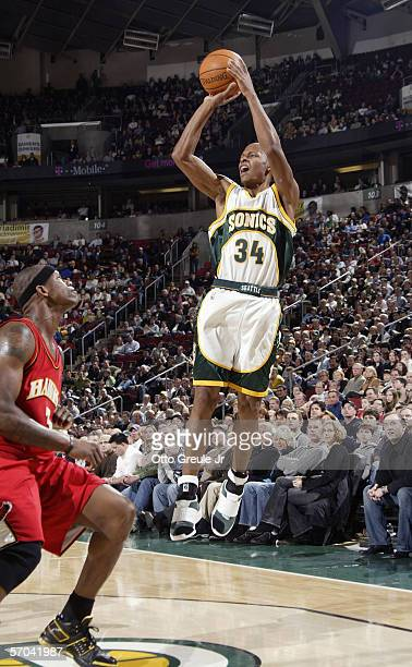 Josh Smith of the Atlanta Hawks tries to block a jump shot by Ray Allen of the Seattle SuperSonics during the game at Key Arena on February 10 in...