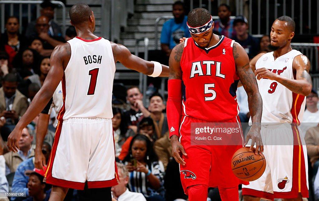 Josh Smith #5 of the Atlanta Hawks walks away after Chris Bosh #1 of the Miami Heat drew a foul from Kyle Korver #26 at Philips Arena on November 9, 2012 in Atlanta, Georgia.