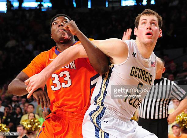 Josh Smith of the Clemson Tigers boxes out against Daniel Miller of the Georgia Tech Yellow Jackets at McCamish Pavilion on February 22 2014 in...