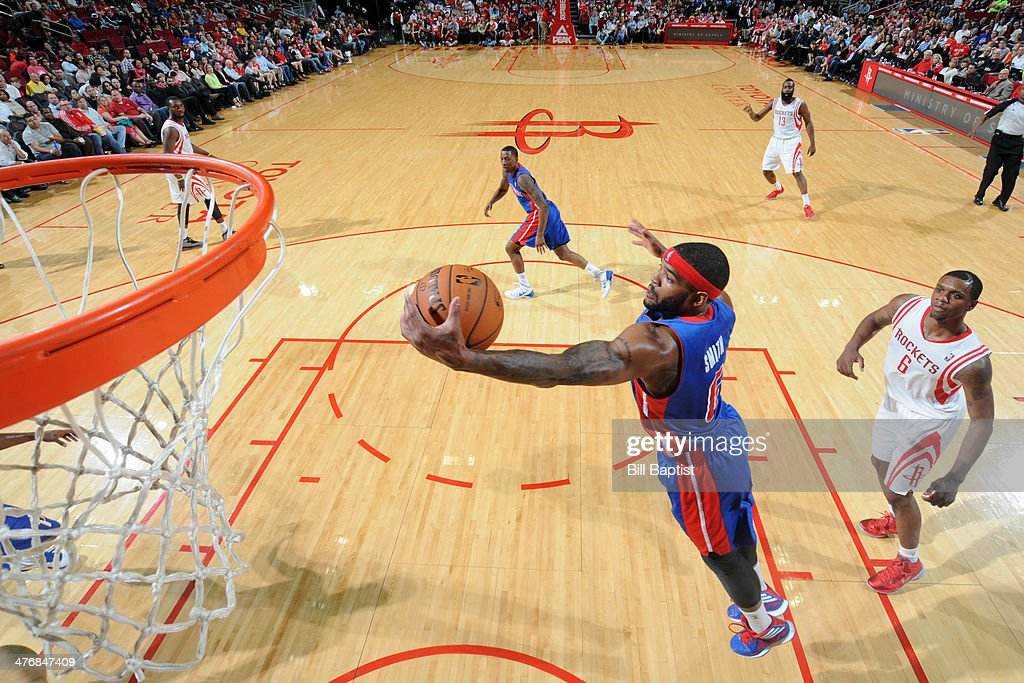 <a gi-track='captionPersonalityLinkClicked' href=/galleries/search?phrase=Josh+Smith+-+Basketball+Player+-+Born+1985&family=editorial&specificpeople=201983 ng-click='$event.stopPropagation()'>Josh Smith</a> #6 of the Detroit Pistons grabs a rebound against the Houston Rockets on March 1, 2014 at the Toyota Center in Houston, Texas.