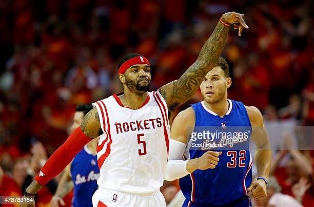 Josh Smith of the Houston Rockets celebrates in the third quarter as Blake Griffin of the Los Angeles Clippers looks on during Game Seven of the...