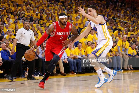 Josh Smith of the Houston Rockets drives on Klay Thompson of the Golden State Warriors in the first half during game five of the Western Conference...