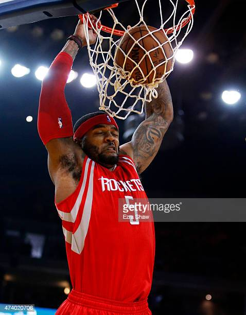 Josh Smith of the Houston Rockets dunks against the Golden State Warriors in the second quarter during Game One of the Western Conference Finals of...
