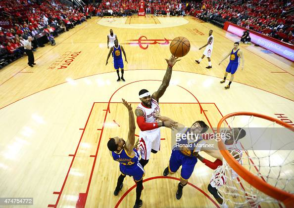 Josh Smith of the Houston Rockets goes up against Andrew Bogut and Shaun Livingston of the Golden State Warriors in the second half during Game Four...