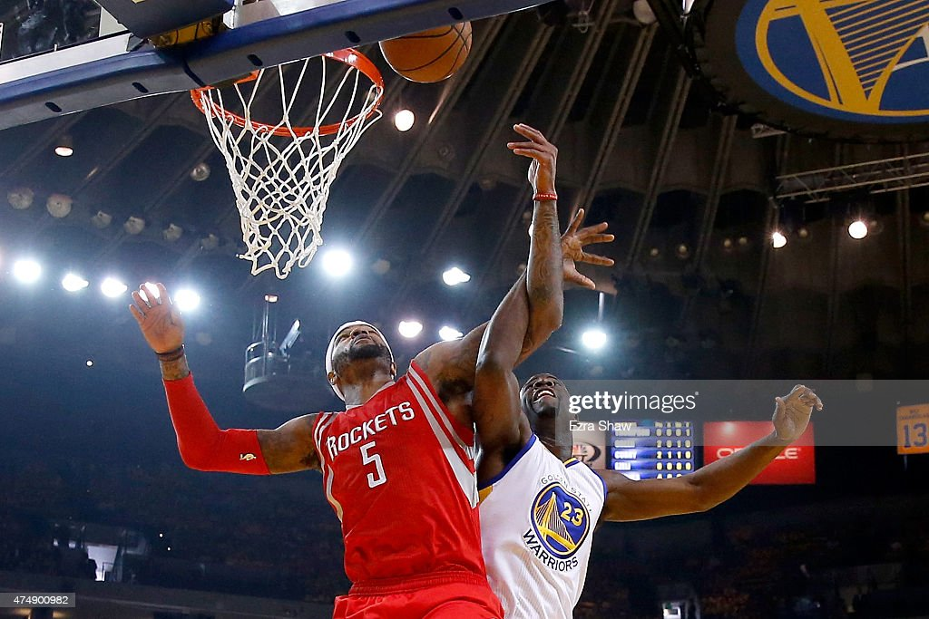 Josh Smith #5 of the Houston Rockets goes up for the ball alongside Draymond Green #23 of the Golden State Warriors in the first half during game five of the Western Conference Finals of the 2015 NBA Playoffs at ORACLE Arena on May 27, 2015 in Oakland, California.