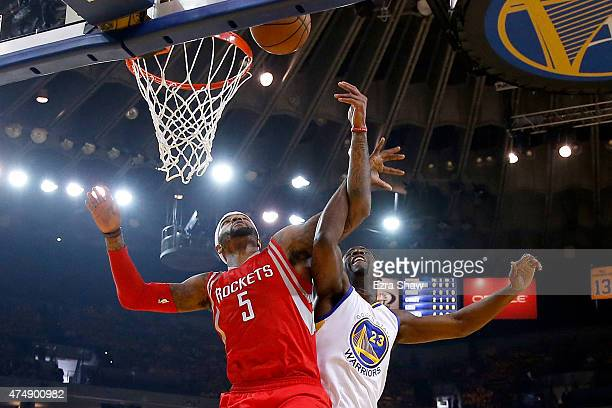 Josh Smith of the Houston Rockets goes up for the ball alongside Draymond Green of the Golden State Warriors in the first half during game five of...
