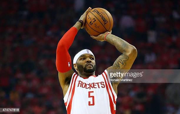 Josh Smith of the Houston Rockets shoots against the Golden State Warriors in the first quarter during Game Four of the Western Conference Finals of...