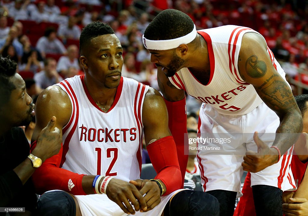 Josh Smith #5 talks to Dwight Howard #12 of the Houston Rockets on the bench in the fourth quarter against the Golden State Warriors during Game Three of the Western Conference Finals of the 2015 NBA PLayoffs at Toyota Center on May 23, 2015 in Houston, Texas.