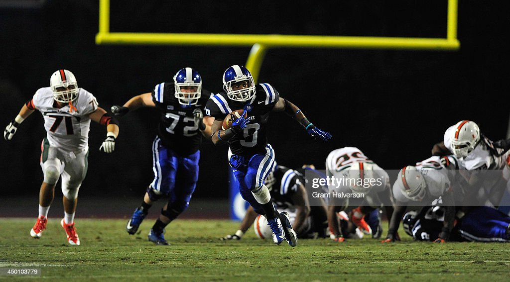 Josh Snead #9 of the Duke Blue Devils breaks through the Miami Hurricanes defense for a long gain during play at Wallace Wade Stadium on November 16, 2013 in Durham, North Carolina. Duke won 48-30.