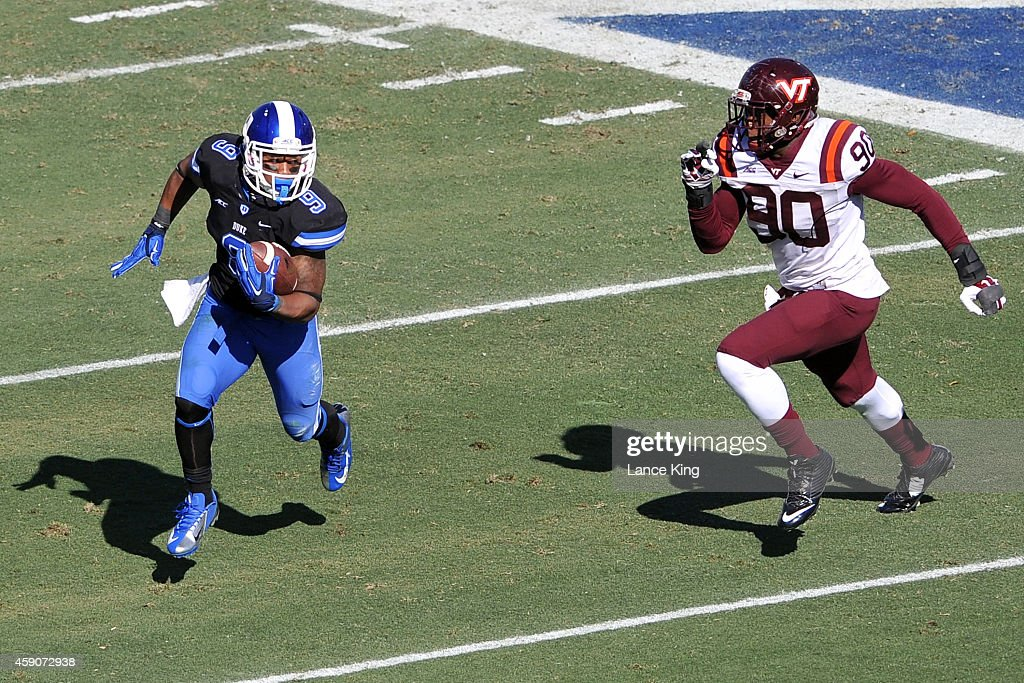 Josh Snead #9 of the Duke Blue Devils runs with the ball against <a gi-track='captionPersonalityLinkClicked' href=/galleries/search?phrase=Dadi+Nicolas&family=editorial&specificpeople=8599685 ng-click='$event.stopPropagation()'>Dadi Nicolas</a> #90 of the Virginia Tech Hokies during their game at Wallace Wade Stadium on November 15, 2014 in Durham, North Carolina. Virginia Tech defeated Duke 17-16.