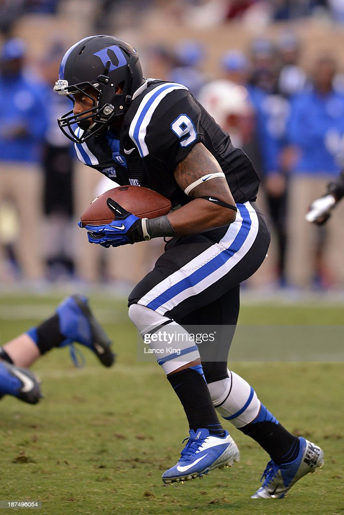 Josh Snead #9 of the Duke Blue Devils runs with the ball against the North Carolina State Wolfpack at Wallace Wade Stadium on November 9, 2013 in Durham, North Carolina.