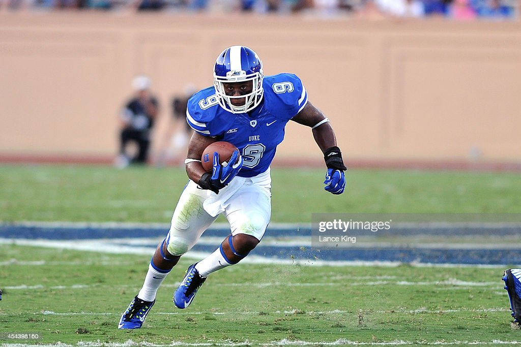 Josh Snead #9 of the Duke Blue Devils runs with the ball against the Elon Phoenix at Wallace Wade Stadium on August 30, 2014 in Durham, North Carolina.