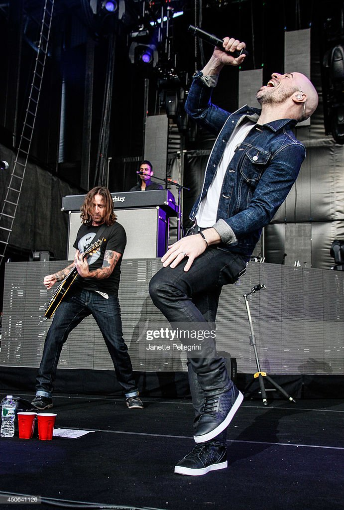 Josh Steely and <a gi-track='captionPersonalityLinkClicked' href=/galleries/search?phrase=Chris+Daughtry&family=editorial&specificpeople=614842 ng-click='$event.stopPropagation()'>Chris Daughtry</a> of Daughtry perform in concert at Nikon at Jones Beach Theater on June 14, 2014 in Wantagh, New York.