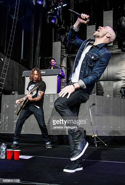 Josh Steely and Chris Daughtry of Daughtry perform in concert at Nikon at Jones Beach Theater on June 14 2014 in Wantagh New York