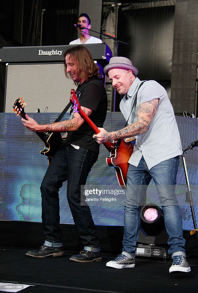 Josh Steely and Josh Paul of Daughtry perform in concert at Nikon at Jones Beach Theater on June 14, 2014 in Wantagh, New York.