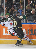 Josh Sterk of the London Knights levels a Niagara IceDog during an OHL game at Budweiser Gardens on February 6 2015 in London Ontario Canada The...