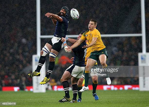 Josh Strauss of Scotland and Drew Mitchell of Australia compete for a high ball during the 2015 Rugby World Cup Quarter Final match between Australia...