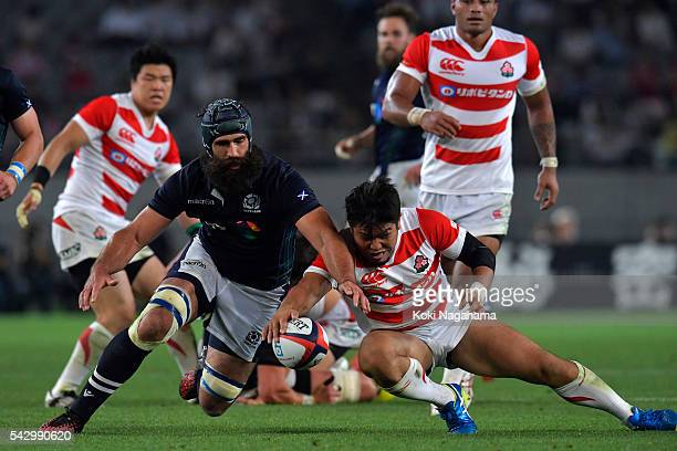 Josh Strauss of Scotland and Shota Horie of Japan compete the ball during the international friendly match between Japan v Scotland at Ajinomoto...