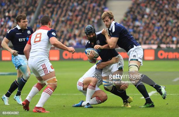Josh Strauss of Scotland gets support from teammate Jonny Gray during the RBS Six Nations match between France and Scotland at Stade de France on...