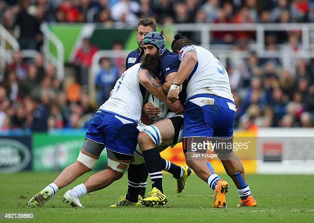Josh Strauss of Scotland is tackled by Jack Lam and Census Johnston of Samoa during the 2015 Rugby World Cup Pool B match between Samoa and Scotland...