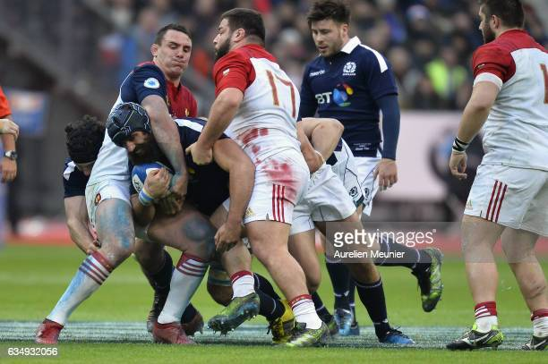 Josh Strauss of Scotland is tackled during the RBS Six Nations match between France and Scotland at Stade de France on February 12 2017 in Paris...
