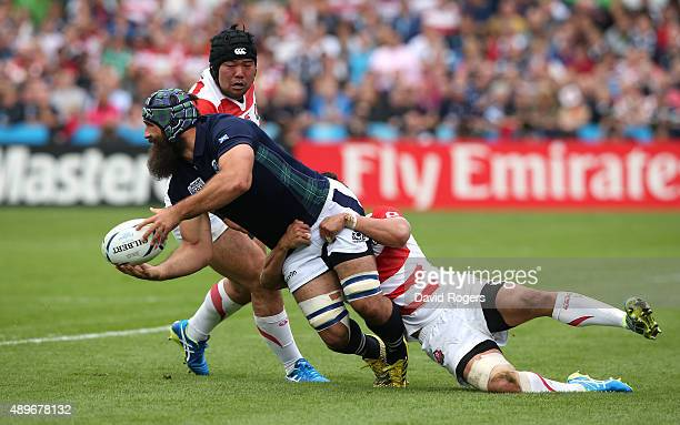 Josh Strauss of Scotland passes the ball during the 2015 Rugby World Cup Pool B match between Scotland and Japan at Kingsholm Stadium on September 23...