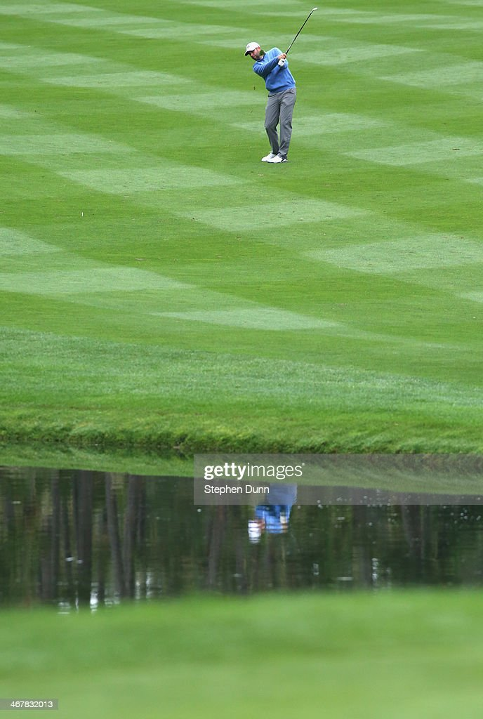 <a gi-track='captionPersonalityLinkClicked' href=/galleries/search?phrase=Josh+Teater&family=editorial&specificpeople=5633301 ng-click='$event.stopPropagation()'>Josh Teater</a> plays a fairway shot during the second round of the AT&T Pebble Beach National Pro-Am at the Spyglass Hill Golf Course on February 7, 2014 in Pebble Beach, California.