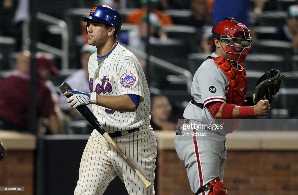 Josh Thole of the New York Mets strikes out to end the game as Carlos Ruiz of the Philadelphia Phillies celebrates the victory on August 14 2010 at...