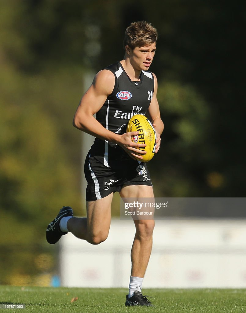 <a gi-track='captionPersonalityLinkClicked' href=/galleries/search?phrase=Josh+Thomas+-+Australian+Rules+Football+Player&family=editorial&specificpeople=14210396 ng-click='$event.stopPropagation()'>Josh Thomas</a> of the Magpies runs with the ball during a Collingwood Magpies AFL training session at Olympic Park on May 2, 2013 in Melbourne, Australia.