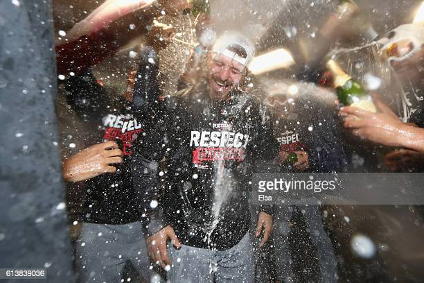 Josh Tomlin of the Cleveland Indians celebrates with teammates in the clubhouse after defeating the Boston Red Sox 43 in game three of the American...