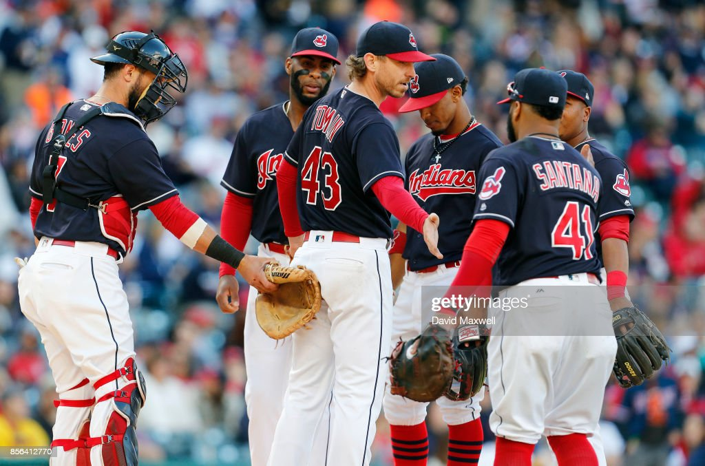 Josh Tomlin #43 of the Cleveland Indians is congratulated by teammates as he leaves the game in the sixth inning against the Chicago White Sox at Progressive Field on October 1, 2017 in Cleveland, Ohio. The Indians defeated the White Sox 3-1.