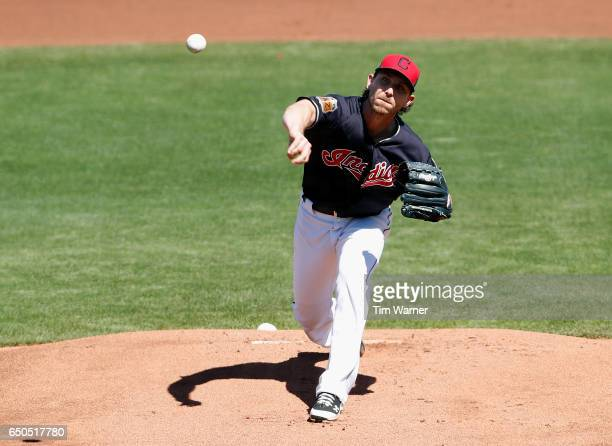 Josh Tomlin of the Cleveland Indians pitches in the first inning against the Los Angeles Angels during the spring training game at Goodyear Ballpark...