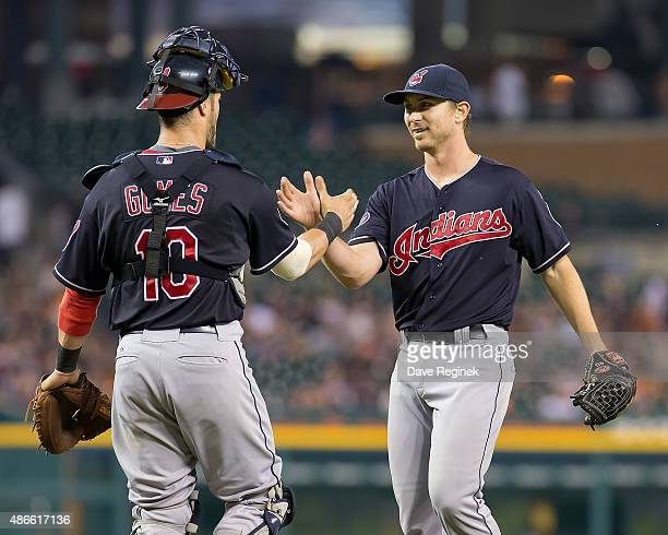 Josh Tomlin of the Cleveland Indians slaps hands with catcher Yan Gomes after pitching a full nine inning game and defeating the Tigers 81 at...